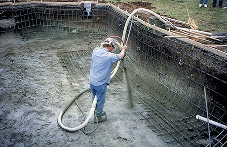 gunite-specialist-applying-materials-with-hose-1.jpg