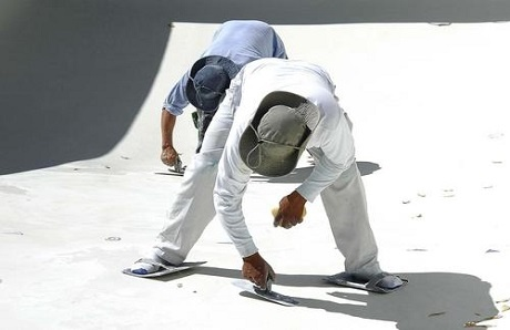 men-applying-plaster-to-inground-pool.jpg