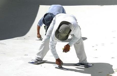 men-applying-plaster-to-inground-pool.jpg
