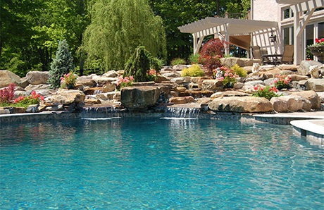 Natural Rock Waterfalls in Swimming Pools 12 Inspiring Examples in