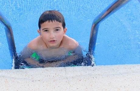 2.boy-in-pool-with-earplugs.jpg