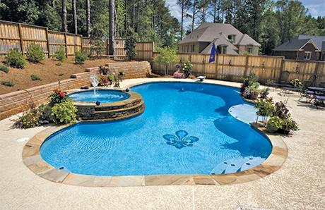 free-form-pool-with-fleur-de-lys-mosaic