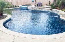 free-form-pool-with-dark-blue-interior-finish