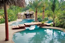 lagoon-style-pool-with-bridge-and-grotto