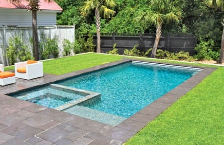 rectangle pool square spa grass and stone deck