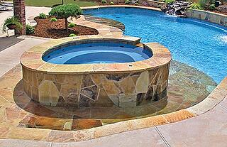 elevated-custom-spa with-flagstone-exterior.jpg