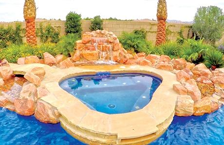 freeform-custom-spa-nested-into-rock-waterfall.jpg