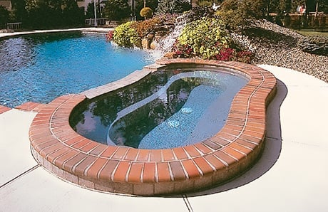 modified-kidney-shape-spa-with-brick-coping.jpg