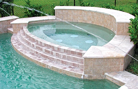 modified-oval-custom-spa-with-tiered-damwall.jpg