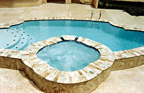 quatrefoil-shape-custom-spa-with-travertine-exterior.jpg