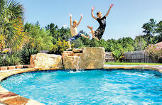 boys-jumping-off-jump-rock-into-pool