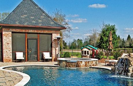 brick-poolhouse-by-pool.jpg
