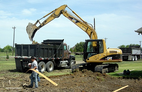 5.excavator-and-dump-truck-building-swimming-pool.jpg