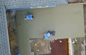 crew installing concrete deck