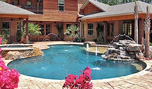 Custom Free From Gunite Pool With Raised Spa.