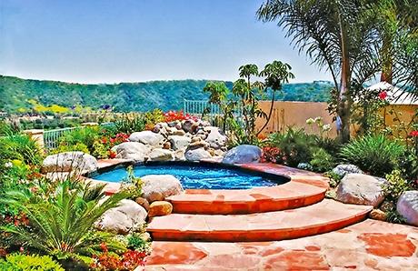 custom-inground-spa-with-rock-waterfall.jpg