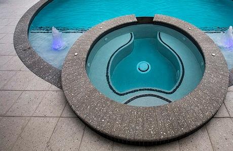 custom-spa-with-grey-coping-and-rectangular-pavers.jpg