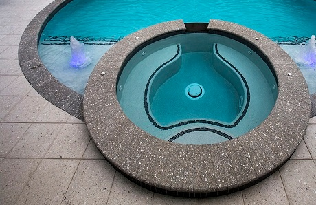 custom-spa-with-grey-coping-and-rectangular-pavers.jpg