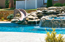 deck-mount-slide-installed-into-rock-waterfall