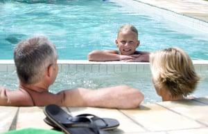 family-enjoying-pool-and-spa