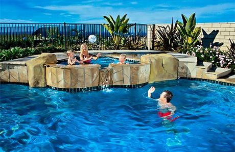 family-enjoying-swimming-pool-with-spa