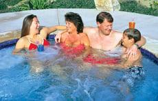family-socializing-in-gunite-spa