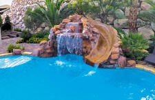 faux-rock-waterfall-and-slide-on-swimming-pool