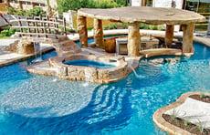 faux-stone-bridge-on-custom-pool