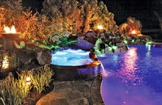 fire-bowls-on-pool-at-night