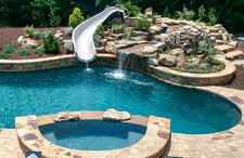 free-form-pool-spa-with-white-slide-waterfall
