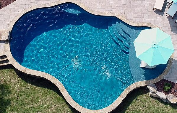 free-form-pool-with-paver-deck