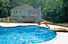 girl-diving-from-jump-rock-into-pool