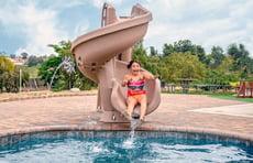girl-on-corkscrew-pool-slide