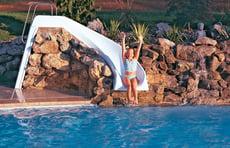 girl-on-pool-slide-integrated-into-rock-waterfall