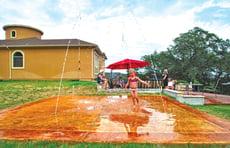 girl-running-through-splash-pad