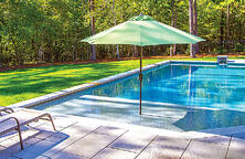 green-umbrella-on-swimming-pool
