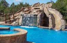 gunite-grotto-rock-waterfall-slide-on-pool