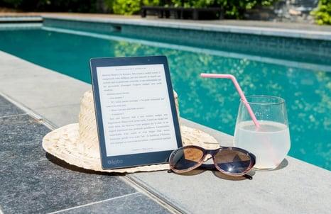hat sunglass tablet poolside