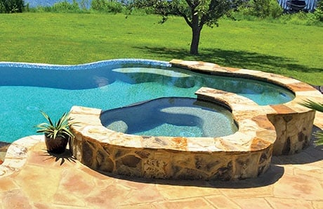 Free Form Concrete Pool Spa with flagstone
