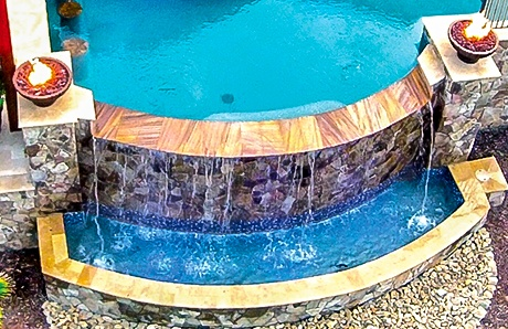 infinity-edge-pool-with-round-fire-bowls