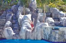 large-pool-rock-waterfall-slide-on-hillside