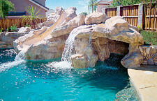 masonry-slide-with-waterfall-grotto-on-pool