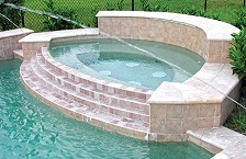 modified-oval-custom-spa-with-tiered-damwall-1.jpg