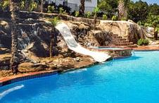 pool-rock-waterfall-slide-built-on-slope