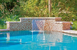 pool-water-features-with-small-pink-and-red-tiles
