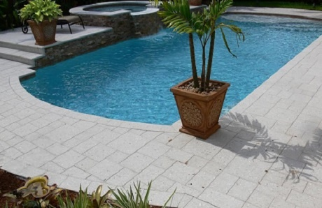 pool-with-raised-spa-and-concrete-paver-deck.jpg