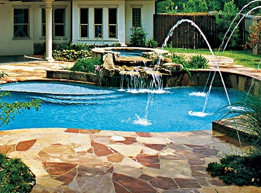 pool-with-spa-with-rock-waterfall-facade.jpg