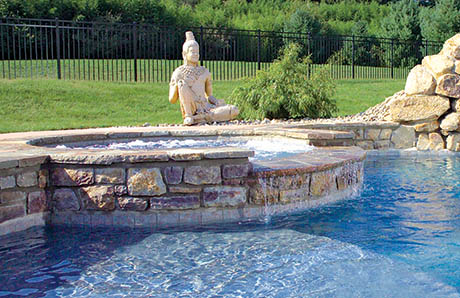 pool-with-spa-with-wide-spillway-stone-facade.jpg
