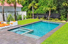 rectangle-inground-pool-with-paver-and-grass-deck