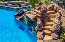 rock-waterfall-slide-pool-with-steps